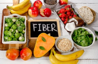 63649162 - high fiber foods on  white wooden background. flat lay